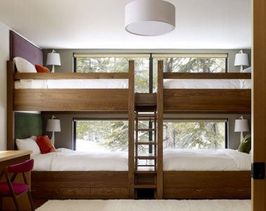 bunk bed in front of window